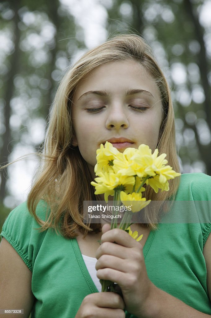 Girl Holding Flowers Stock Photo | Getty Images