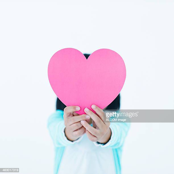 Girl Holding Heart Shape Paper Cut Out