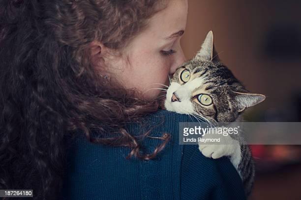 Girl holding her cat