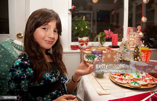 Girl holding her Xmas cookie