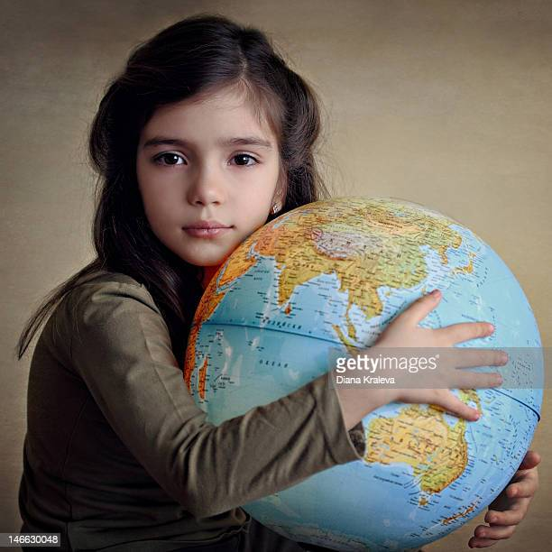 Girl holding in his hands Earth