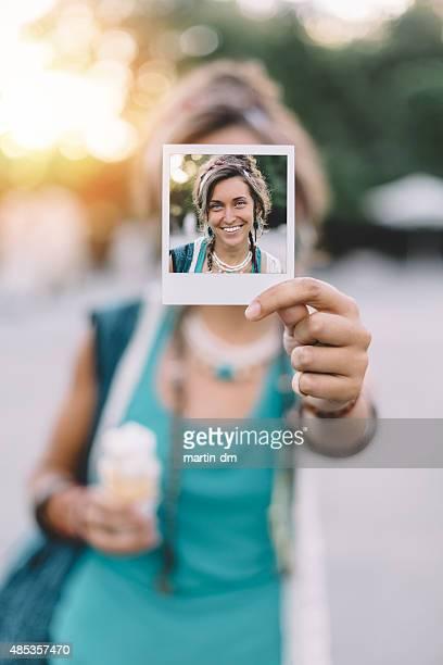 Girl holding instant photo