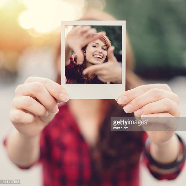 Girl holding instant selfie