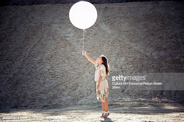 Girl holding large balloon