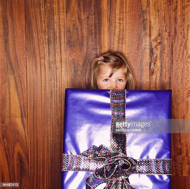 Girl holding large gift