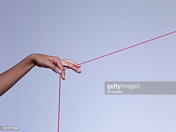 girl holding on to string