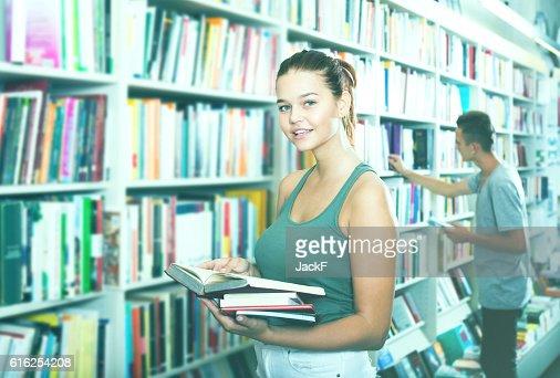 Girl holding open book in hands : Foto de stock