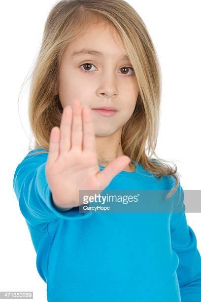 Femme tenant la main pour faire une pause