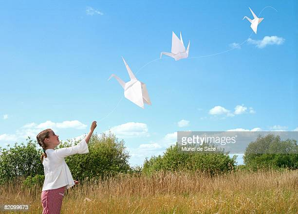 Girl holding paper bird