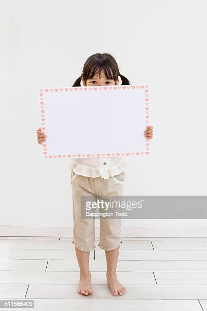 Girl Holding Placard