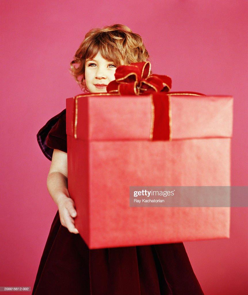 Girl (4-6) holding red box with velvet bow : Stock Photo