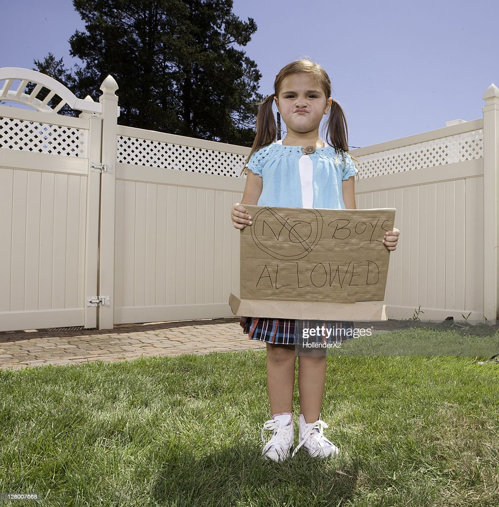 girl holding sign 'no boys allowed' : Stock Photo