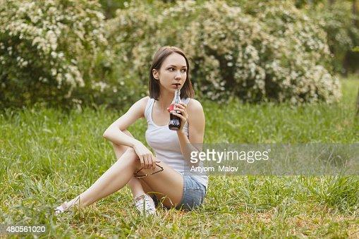 Girl, holding soda and sunglasses : Stock Photo