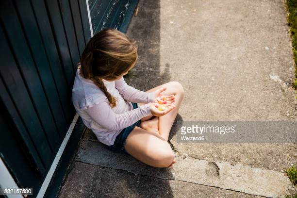 Girl holding sweets in her hands