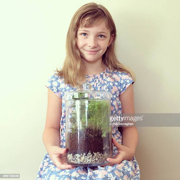 Girl Holding Terrarium