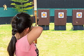 Girl aiming with a bow and arrow