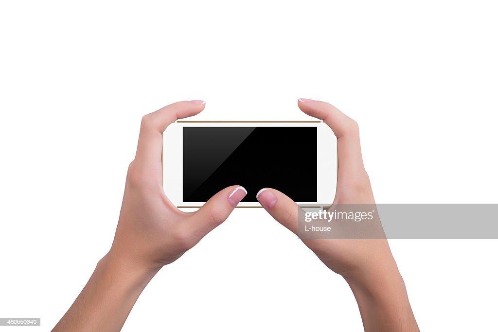 Chica sosteniendo el teléfono con ambas manos oro : Foto de stock