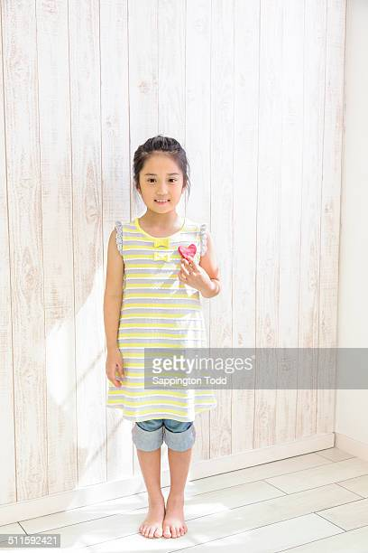 Girl Holding Toy Heart