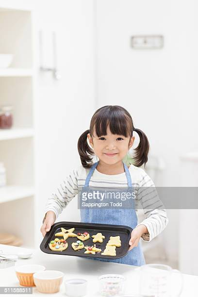 Girl Holding Tray Of Cookie