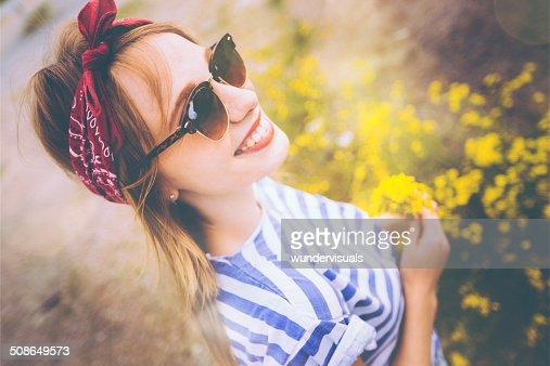 Girl Holding Wildflowers : Stock Photo