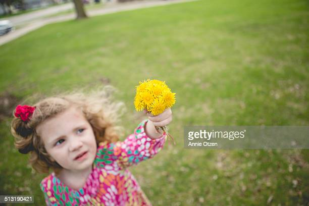 Girl holding yellow flowers