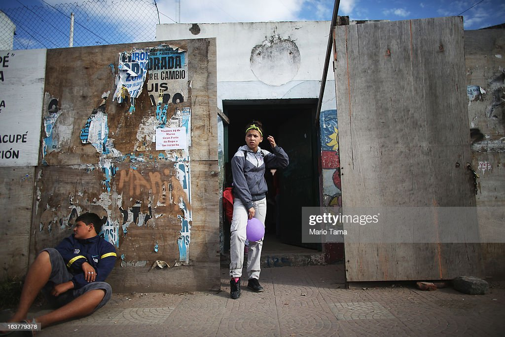 A girl holds a balloon next door to the Virgin of the Miracles of Caacupe church in the Villa 21-24 slum, where archbishop Jorge Mario Bergoglio, now Pope Francis, used to perform charity work, on March 15, 2013 in Buenos Aires, Argentina. Francis was the archbishop of Buenos Aires and is the first pope to hail from South America. Some locals are now affectionately calling Francis, known for his charity work in the slums, the 'slum pope.'