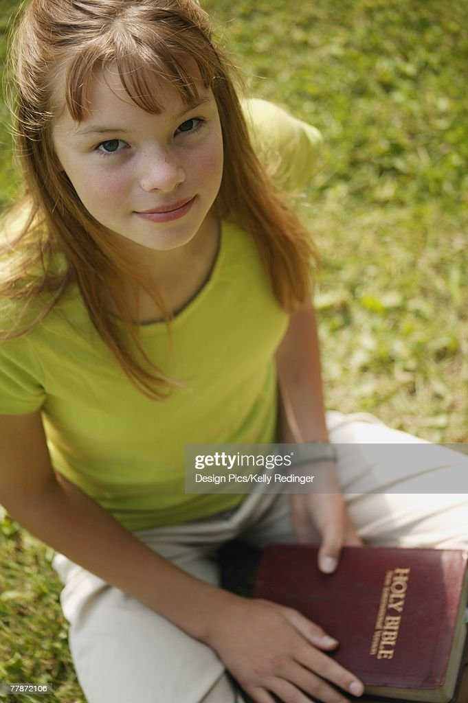Girl Holds A Bible