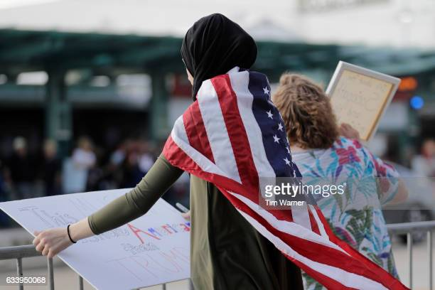 A girl holds a sign at a demonstration protesting President Trump near NRG Stadium site of Super Bowl LI on February 5 2017 in Houston Texas