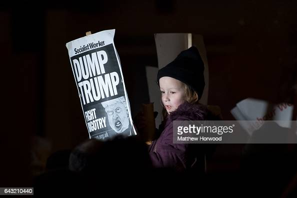 A girl holds a sign during a protest on Queen Street against plans for a state visit to the UK by President Donald Trump on February 20 2017 in...