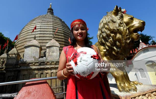 A girl holds matchball with Kamakhya Temple in the background during the FIFA U17 World Cup India 2017 tournament on October 10 2017 in Guwahati India