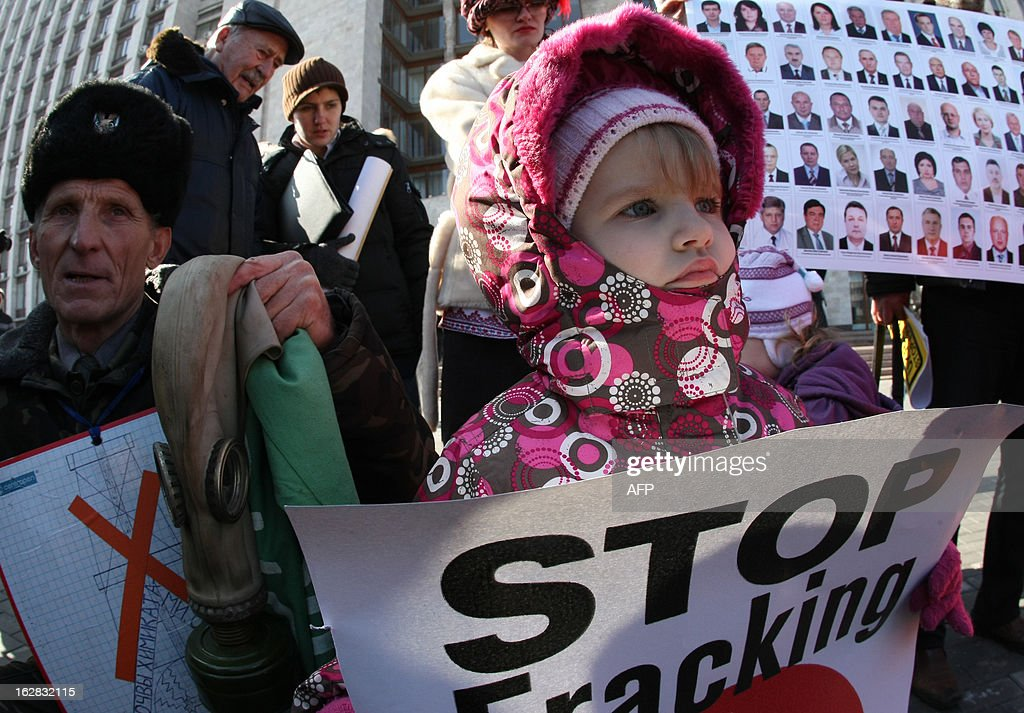 A girl holds on February 28, 2012 a placard, reading 'Stop fracking,' during a protest organized by a women's group in the center of the Ukrainian industrial city of Donetsk against shale gas production by Shell in the Donetsk region. Ukraine and the global oil giant Royal Dutch Shell signed on January 24 a 10 billion US dollar shale gas production sharing agreement aimed at helping the ex-Soviet nation ease its dependence on Russia. The Ukrainian government estimates the eastern Donetsk location may hold three trillion cubic metres (100 trillion cubic feet) of natural gas -- enough to last the nation of 46 million people 70 years at current consumption rates.