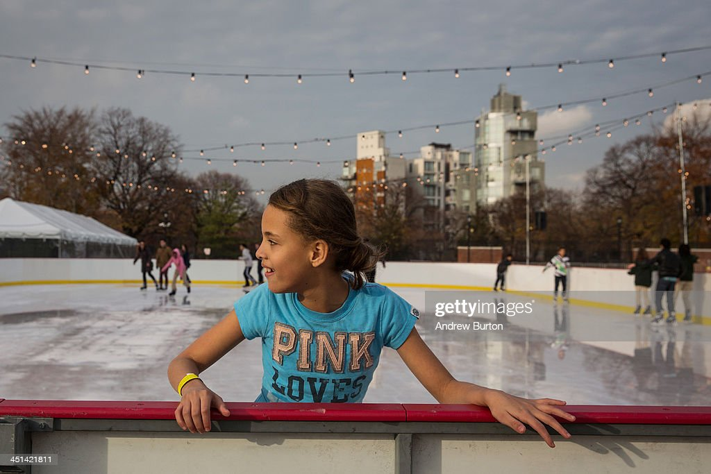 A girl holds on to the railing while ice skating at the ice rink at McCarren Pool, which opened for the winter months last week, on November 22, 2013 in the Green Point neighborhood of the Brooklyn borough of New York City. McCarren Pool originally opened in 1936, though it closed in 1984; it reopened in 2012 after a multimillion dollar remodeling. The winter ice rink was unable to open last winter due to complications; this year it is scheduled to stay open through January 5th, 2014.
