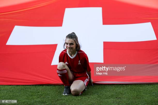 A girl holds the flag prior the Group C match between Austria and Switzerland during the UEFA Women's Euro 2017 at Stadion De Adelaarshorst on July...