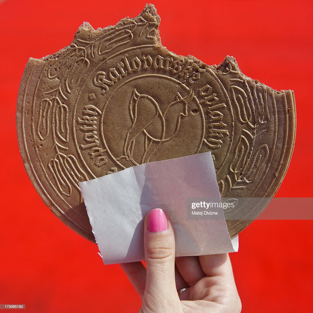 Girl holds traditional Karlovy Vary spa wafer during the 48th Karlovy Vary International Film Festival (KVIFF) on July 05, 2013 in Karlovy Vary, Czech Republic.