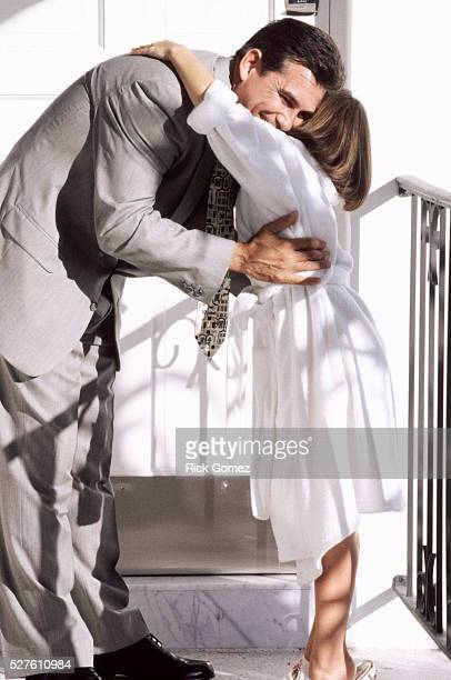 Girl hugging her father goodbye in the morning