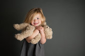 Girl hugging her teddy