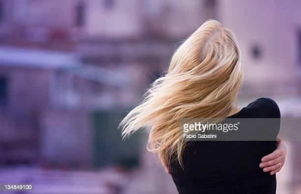 Girl hugging herself in wind