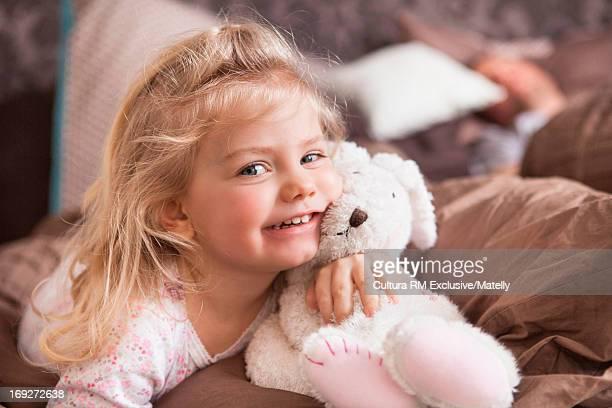 Girl hugging soft toy