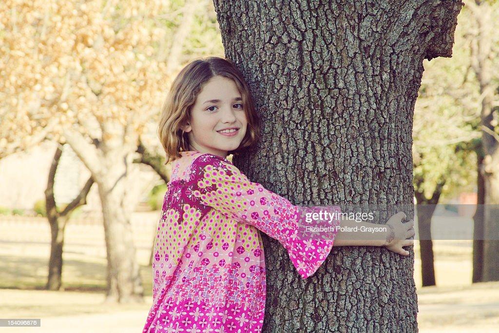 girl hugging tree : Stock Photo