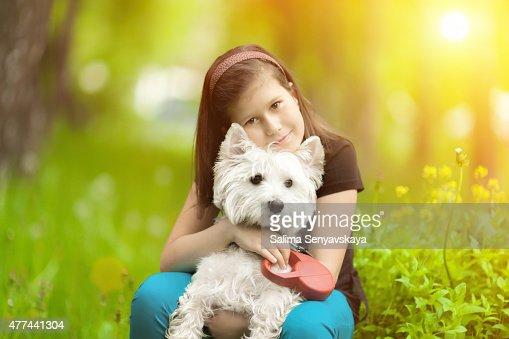 Girl hugging westie