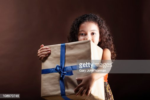 girl hugs big gift : Stock Photo
