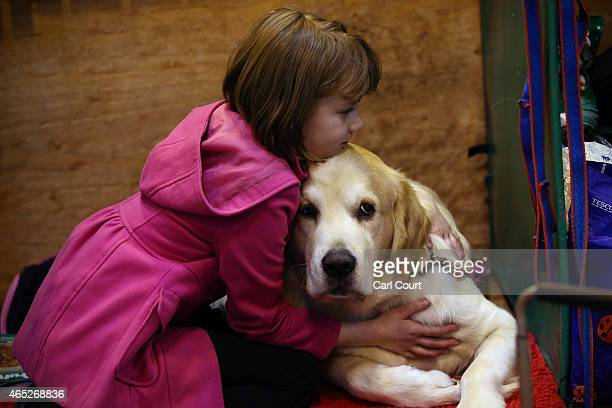 A girl hugs her dog on the first day of Crufts dog show at the National Exhibition Centre on March 5 2015 in Birmingham England First held in 1891...