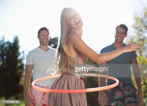Girl hula hooping outdoors : Stock Photo