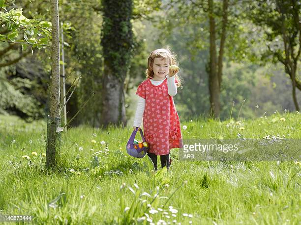 Girl hunting for Easter eggs