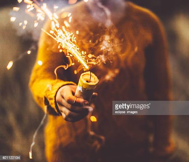 Girl igniting smoke bomb