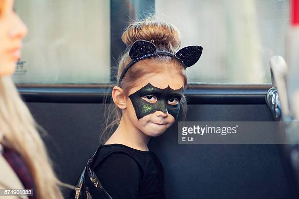 Girl in a bat costume for Halloween