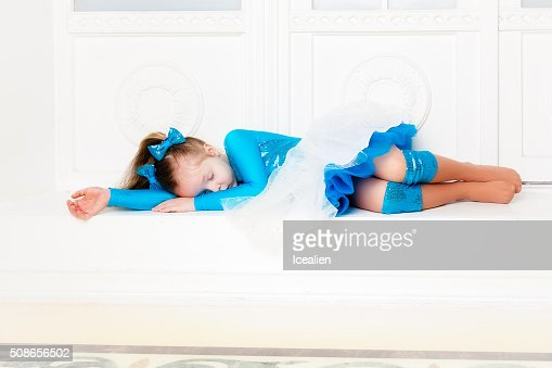 Girl in a blue dress is sleeping : Stock Photo