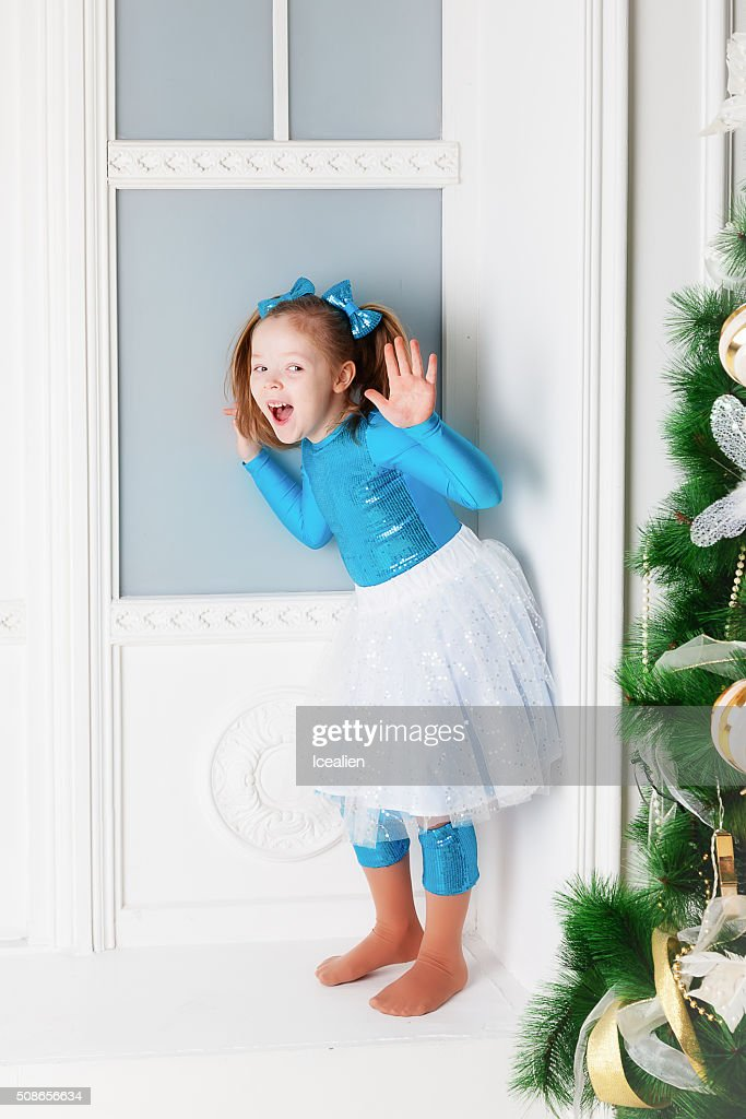 Girl in a blue dress : Stock Photo