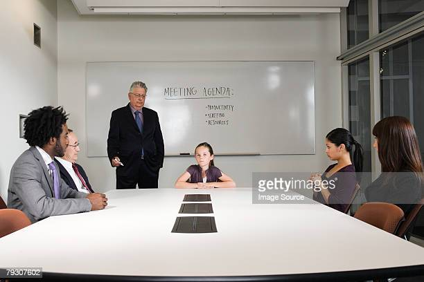 A girl in a boardroom meeting