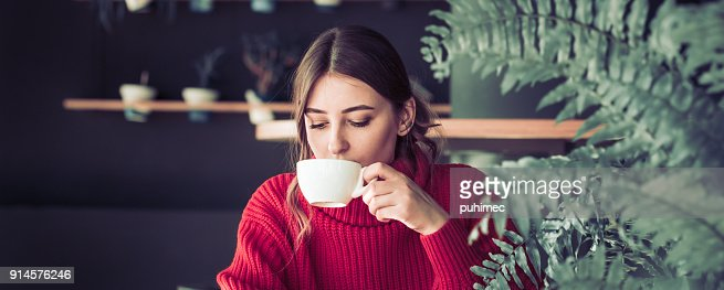 Girl in a cafe drinking tea : Stock Photo